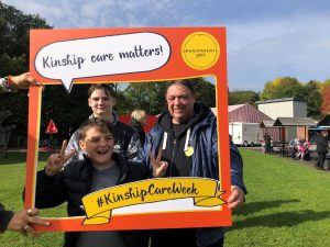 Kinship carer and two boys at celebration day
