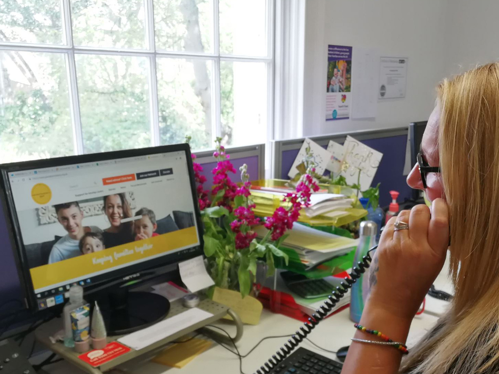 advice worker on the phone